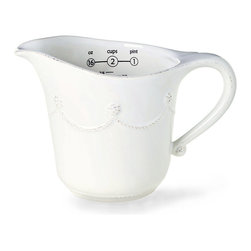 Berry and Thread Measuring Cup - A chic and charming ceramic accent for the transitional kitchen, the Berry and Thread Measuring Cup is functional, attractive, and pleasingly versatile, though formal country roots are evident in its dimensional detailing and whitewash finish. The pulled handle with its berry finial offers an especially notable element in this graceful decorative measuring cup.