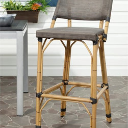 Safavieh - Safavieh Deltana Barstool - FOX5208B - Shop for Chairs and Sofas from Hayneedle.com! Break out the tiki torches the Safavieh Deltana Barstools and a few mixed drinks in coconut shells and get ready for some summer fun. The combination of bamboo-style frame and wicker wrap produces a distinctly tropical appearance. And the aluminum and PE wicker construction guarantee a long life based on superior materials able to stand up to the elements. The footrest and the convenient lower backrest are sure to make these stools comfortable seating for hours of conversation putting you in that relaxing equatorial spirit.About SafaviehConsidered the authority on fine quality craftsmanship and style since their inception in 1914 Safavieh is most successful in the home furnishings industry thanks to their talent for combining high tech with high touch. For four generations the family behind the Safavieh brand has dedicated its talents and resources to providing uncompromising quality. They hold the durability beauty and artistry of their handmade rugs well-crafted furniture and decorative accents in the highest regard. That's why they focus their efforts on developing the highest quality products to suit the broadest range of budgets. Their mission is perpetuate the interior furnishings craft and lead with innovation while preserving centuries-old traditions in categories from antique reproductions to fashion-forward contemporary trends.