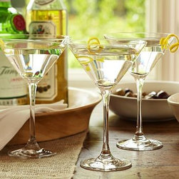 """Schott Zwiesel Martini Glass, Set of 6 - Our Schott Zwiesel martini glasses are the perfect complement to a classic cocktail. Each is crafted from Tritan crystal for exceptional resilience and clarity. 4.5"""" diameter, 7"""" high; 9 fluid-ounce capacity Made of Schott Zwiesel Tritan crystal, an advanced type of pure, hard glass that's rigorously tested for incredible durability and resistance to chipping and breakage. Dishwasher-safe. Monogramming is available at an additional charge. Monogram will be centered on the side of each glass. Made in Germany. Set of 6."""