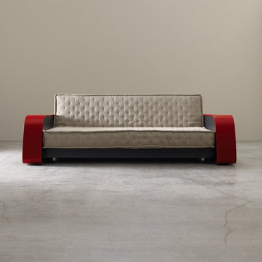 Didimo Sofa Bed - I adore this sofa. The red arms and the tufted upholstery are simply stunning. And all you have to do is pull the seat out, and the back folds down to create a bed. I'd buy this even if it didn't turn into a bed!