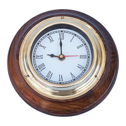 """Handcrafted Model Ships - Brass/Wood Nautical Wall Clock - The Hampton Nautical Clock on wood base 7"""" is a smaller wall clock that is made of brass and wood. This 7-inch nautical clock features big Roman numerals with 1-minute intervals. The back of the clock features a hinge to hang the clock on the wall. A real brass nameplate is featured on the back with the name """"Hampton Nautical."""" This clock on wood base requires AA batteries to operate (not included)."""