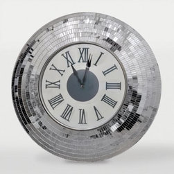 Ren-Wil Kythira Clock - 24 diam. in. - Silver - Inspired by the iconic disco ball, this Ren-Wil Kythira Clock - 24 diam. in. - Silver lets you know it's always time to party. Sure to add sparkle to your space, this battery-operated clock is made of iron with a mirrored mosaic frame. Stately black hands and Roman numerals add a distinguished touch to this beauty.About Ren-WilFor over 45 years, Ren-Wil has been creating quality wall decor, mirrors, and lighting that enhances any space. The company's talented team of in-house artists travels the world to find the newest materials, fashions, and trends, and then applies them to their work. The team also uses multi-media designs for many of their pieces. Ren-Wil is the leader in Alternative Wall Décor and is the market leader in Canada. They thrive on offering a fresh, innovative product line and superior customer service.
