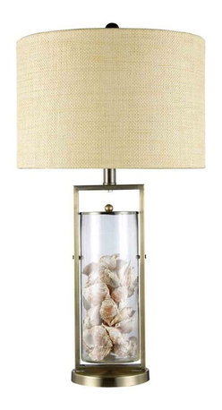 Dimond Lighting - Dimond Lighting D1978 Millisle Brass Table Lamp - Millisle Table Lamp in Antique Brass and Clear Glass with Shells Inside and Natural Linen Shade with Cream Liner