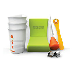 Frontgate - Zoku Tool Kit - Six reusable pop sticks with drip guards included. Super Tool quickly releases the frozen treats from their molds. Makes up to 9 pops before refreezing the unit again. Available is several color options. BPA and phthalate free. Beat the heat fast with the Zoku Quick Pop Maker . You can quickly create delicious striped pops, yogurt pops, or fruit-flavored pops in as little as seven minutes right on your kitchen countertop without electricity. To make pops at a moment's notice, simply store the compact base in your freezer. The included reusable pop sticks and Super Tool ensure your pops are perfect every time.  .  .  . .  .