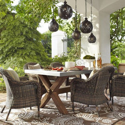 Torrey All-Weather Wicker Dining Armchair - I love all of the curves and the beautiful rustic tones in these chairs.