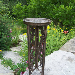 Oakland Living - Oakland Living Vineyards Wrought Iron Interlocking Plant Stand Planter - Our plant table stands are the perfect addition to any setting bringing beauty and style both indoors and out. Constructed of durable cast iron this grape interlocking stand features a hardened powder coated finish for years of beauty. The Oakland vineyard collection is perfect for fruit and wine lovers alike. Each piece is adorned with twisty grape vines and ripe clusters of grapes. The attractive grape vines will add beauty and style to any outdoor patio garden setting. Each piece is hand cast and finished for the highest quality possible.For more than 15 years Oakland Living has been making wrought iron aluminum and resin wicker patio furniture and has built a reputation around their quality construction and superior value. Their furniture is made to weather even the most inclement conditions and stay looking good year after year. Because their items are warehoused here in the U.S. you will enjoy quick shipping on all your patio furniture purchases. Features include Easy to Follow Assembly Instructions and Product Care Information Metal Hardware Some Assembly Required 1 Year Limited Manufacturers Warranty Other Items Available in Collection We recommend that the products be covered to protect them when not in use. To preserve the beauty and finish of the metal products we recommend applying an epoxy clear coat once a year. However because of the nature of iron it will eventually rust when exposed to the elements.. Specifications Finish: Antique Bronze.