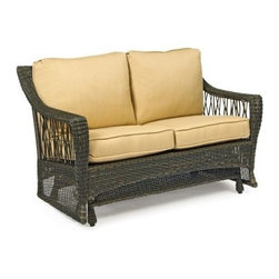 Woodard Serengeti All Weather Wicker Gliding Loveseat - Get a different view of the backyard landscape - or date night with your sweetheart - from the cozy cushions of the Woodard Serengeti All Weather Wicker Gliding Loveseat. Crafted with durable weather-resistant resin wicker over a sturdy aluminum frame, this spacious two-seater loveseat boasts a rustic, twig-like weave along the sides and high back, finished with curved arms, tightly woven trim, and a semi-sheer woven base. Underneath, a smooth gliding mechanism provides soothing back-and-forth movement. The natural patterns are highlighted by a deep brown shade, offset by plush, all-weather fabric cushions available in your choice of colors and patterns.Important NoticeThis item is custom-made to order, which means production begins immediately upon receipt of each order. Because of this, cancellations must be made via telephone to 1-800-351-5699 within 24 hours of order placement. Emails are not currently acceptable forms of cancellation. Thank you for your consideration in this matter.Woodard: Hand-crafted to Withstand the Test of TimeFor over 140 years, Woodard craftsmen have designed and manufactured products loyal to the timeless art of quality furniture construction. Using the age-old art of hand-forming and the latest in high-tech manufacturing, Woodard remains committed to creating products that will provide years of enjoyment.Superior Materials for Lasting DurabilityIn the Aluminum Collections, Woodard's trademark for excellence begins with a core of seamless, virgin aluminum: the heaviest, purest, and strongest available. The wall thickness of Woodard frames surpasses the industry's most rigid standards. Cast aluminum furniture is constructed using only the highest grade aluminum ingots, which are the purest and most resilient aluminum alloys available. These alloys strengthen the furniture and simultaneously render it malleable. The end result is a fusion of durability and beauty that places Woodard 