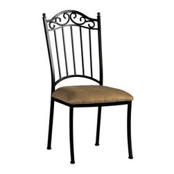 Chintaly Bethel Wrought Iron Dining Side Chairs - Set of 2 - The classic design of the Chintaly Bethel Wrought Iron Dining Side Chairs - Set of 2 make a perfect addition to your dining room set. The perfect match to the Bethel dining table, you'll love the beautiful look of these chairs in your home.About Chintaly ImportsBased in Farmingdale, New York, Chintaly Imports has been supplying the furniture industry with quality products since 1997. From its humble beginning with a small assortment of casual dining tables and chairs, Chintaly Imports has grown to become a full-range supplier of curios, computer desks, accent pieces, occasional table, barstools, pub sets, upholstery groups and bedroom sets. This assortment of products includes many high-styled contemporary and traditionally-styled items. Chintaly Imports takes pride in the fact that many of its products offer the innovative look, style, and quality which are offered with other suppliers at much higher prices. Currently, Chintaly Imports products appeal to a broad customer base which encompasses many single store operations along with numerous top 100 dealers. Chintaly Imports showrooms are located in High Point, North Carolina and Las Vegas, Nevada.