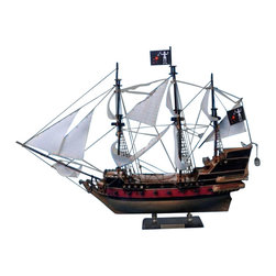 Handcrafted Nautical Decor - Blackbeard's Queen Anne's Revenge 24'' - White Sails - --SOLD FULLY ASSEMBLED--Ready for Immediate Display - Not a Model Ship kit��--Brought to the silver screen in   Disney�s Pirates of the Caribbean: On Stranger Tides, the legendary   Queen Anne's Revenge has been stunningly recreated in this fabulous   model ship. In the movie Johnny Depp returns as Captain Jack Sparrow and   crosses paths with the infamous pirate Blackbeard (Ian McShane),   dreaded captain of the Queen Anne's Revenge, while searching for the   fabled Fountain of Youth. ----Set sail for adventure on the high   seas as you search for lost treasure aboard this scale tall model ship   replica of a Blackbeard�s feared pirate ship, the Queen Anne�s   Revenge.�Fine craftsmanship and attention to detail highlight this   exquisitely constructed tall sailing pirate ship.�Whether seated upon a   shelf, desk, or table, proudly display this Queen Anne�s Revenge pirate   ship model and enjoy its indomitable spirit of adventure!�----�----    Handcrafted by our master artisans--    Individual wooden planks used      in hull construction--    High quality woods include cherry,      birch, maple and rosewood--    Extensive rigging features over 100      blocks and deadeyes--    Gun ports actually cut into      the hull--    Amazing Details, including:--    --        Planked deck with       nail holes--        Authentic scale       lifeboat with oars--        Rudder chains,       metal anchors, cannonball racks--        Fine-crafted       embellishments carved on the stern--        Additional deck       details such as cannon balls, barrels, ladders and other nautical items--        11 masterfully       stitched white canvas sails hold shape and do not wrinkle --        Taut rigging with       varied thread gauge and color--    --    --    Meticulous painting accurately matches      the real Queen Anne�s Revenge--    --        Wooden display       base--    --    --    Extensive resear