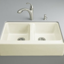 KOHLER - KOHLER K-6534-4U-KA Hawthorne Apron-Front, Undercounter Kitchen Sink with Four-H - KOHLER K-6534-4U-KA Hawthorne Apron-Front, Undercounter Kitchen Sink with Four-Hole Oversized Centers in Black 'n Tan The Hawthorne is a standard-sized double-basin kitchen sink with clean, classic lines. The basins are moderately deep, offering easy access to any workspace. Made of durable KOHLER(R) Cast Iron, the look is understated but elegant, with its simple apron-front design. This model is available in a palette of KOHLER colors and offers an undercounter installation with an oversized four-hole faucet drilling.Please see our Delivery Notes for Freight Shipments for products that are oversized and/or are too heavy to ship UPS ground. KOHLER K-6534-4U-KA Hawthorne Apron-Front, Undercounter Kitchen Sink with Four-Hole Oversized Centers in Black 'n Tan , Features:• Combining the functionality of a double-basin sink with the charm of apron-front styling