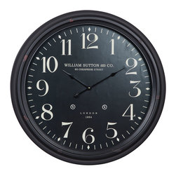 Cooper Classics - Norton Clock - The Norton clock will make a wonderful addition to any room. This lovely wall clock features a face under glass and an aged black finish that will accent any decor.