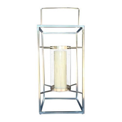 Used Large Outdoor Candle Lantern - Class up your outdoor space with this strikingly simple metal lantern. It includes 1 flameless candle, and can be set on the ground or easily hung. It is in new and perfect condition.