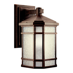 Kichler 1-Light Outdoor Fixture - Prairie Rock Exterior - One Light Outdoor Fixture With the look of handcrafted finery, the simple design of this energy efficient arts and crafts wall lantern from our Cameron collection is skillfully interpreted for today's homeowner. The finish is our exclusive prairie rock adorned with white-etched linen glass panels. 1-light, 12700k pls 18-w. Lamp included. Photocell included. Width 8, height 14-1/2, extension 9-1/2. Height from center of wall opening 3-3/4. Backplate size: 6 x 10-1/4. Replacement bulb 4021, replacement ballast 4032. U. L. Listed for wet location