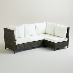 Solano Outdoor Sectional - I love a patio or porch that has room for lounge seating. This sectional would be at the top of my list if I had room for it. The contrast of the base against the white cushions is perfect.