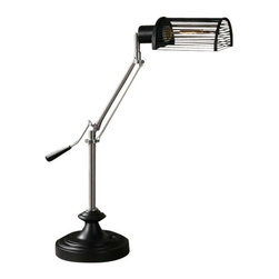 Uttermost Barnsley Desk Lamp - Rust silver metal with matte black details. Base pivots up and down. 40 watt antique style tubular bulb included. Rust silver metal with matte black details. Base pivots up and down. 40 watt antique style tubular bulb included. The shade is a black metal cage.