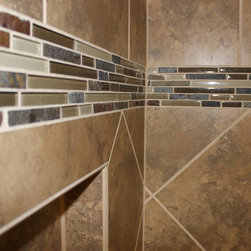 """Bathroom Remodel, Strongsville, OH #1 - We updated this main bathroom by installing Capri Tile Collection, Sandy Ridge Mosiacs Border 13 x 13 on the walls and 2 x 2 on the floors with 3 x 12 bullnose.  The Shower door is a 3/16"""" Rain Glass Slider - Semi-Framelss  Traditional Euro Shower enclosure with a Moen hand shower and bar and a bench and cubby niche were installed"""