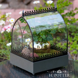 H. Potter - H. Potter Old World Wardian Case Terrarium Multicolor - WAR142 - Shop for Greenhouses from Hayneedle.com! Displaying simplicity and elegance at its best the H. Potter Old World Wardian Case Terrarium is a wonderful accent piece. An old world flair and charm is reflected in its design. This terrarium has a metal frame and lattice with curved glass sides and green jewel accents. The splash of color inside the terrarium further enhances its visual appeal. Infusing a touch of nature into your ambience this terrarium is sure to be a nature lover's favorite home accent. About H. Potter ProductsOver the past nine years H. Potter has continually enhanced all aspects of their business to fill the desires of their growing list of satisfied customers. With the entrance of 2006 they were able to offer over 100 impressive designs. Not only are they always striving to bring you products that are new bold and unique but they also work hard to increase the overall quality of the items. They do this by incorporating heavier materials stainless steel hardware and dramatically expanding their copper container business. H. Potter artisans design many 100% hand-made pieces to fit effortlessly into your home or garden setting.