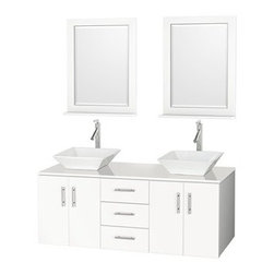 "Modern Bathroom - Arrano 55"" Double Bathroom Vanity - White with Vessel Sinks - The Arrano Double Vanity Set features compact design in a double vanity with plenty of storage, blending simple lines and clean design with modern elements like vessel sinks and brushed nickel hardware, resulting in a modern yet timeless piece of bathroom furniture. The Arrano comes standard with a white man-made stone counter and porcelain vessel sinks. Featuring soft close door hinges, meticulously finished with brushed nickel hardware, the attention to detail on this stunning vanity is second to none. Now available with custom CaesarStone Counters for the perfect look in any bathroom. Custom counters require 3 weeks manufacturing time. The Arrano is available in multiple sizes and finishes. Features Constructed of beautiful veneers over the highest grade MDF 8-stage painting and finishing process Modern wall mounted installation Deep doweled drawers Fully extending side-mount drawer slides Soft-close doors Concealed door hinges White man-made stone counter with large porcelain sinks Single-hole faucet mount Faucet not includedMatching mirror available Metal hardware with brushed chrome finish Four doors, three drawers How to handle your counter Spec Sheet --> Please note that all custom natural stone and Caesarstone counters are proudly manufactured in the USA specifically for your order, and so require up to 3 weeks manufacturing time. Caesarstone Carbone, Starry Night, Spring Blossom, and Marrone are made from recycled content. Quartz Reflections and Ruby Reflections colors are made with up to 35% post-consumer recycled glass. Chocolate Truffle and Smoky Ash colors are made with up to 17% post-consumer recycled glass.Natural stone like marble and granite, while otherwise durable, are vulnerable to staining from hair dye, ink, tea, coffee, oily materials such as hand cream or milk, and can be etched by acidic substances such as alcohol and soft drinks. Please protect your sink by avoiding contact with these substances. For more information, please review our ""Marble & Granite Care"" guide."