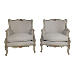 French Louis XV-Style Armchairs - Pair of 1930s French armchairs in Louis XV-style. The frame is from solid wood with nice floral carvings on the top center, bottom center and legs, the frame is painted in a light green with gold leaf accents on the carvings. It has been newly upholstered in a sand color fabric, with double piping along the trim, and a single cushion seat made from feathers and polyester.