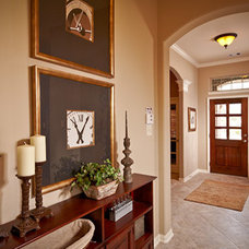 Traditional Hall by PLANTATION HOMES - Built Around You