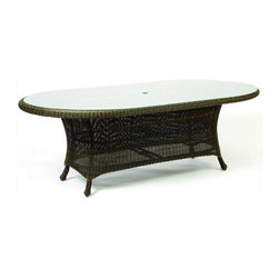 Woodard - Serengeti Woven Dining Table w Glass Top - Wicker frame. 80 in. W x 47 in. D x 29 in. H. All products are made to order. Orders cannot be cancelled after 5 calendar days. If order is cancelled after 5 calendar days, a 50% restocking fee will be applied.