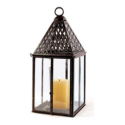 "Frontgate - Large Trident Outdoor Lantern - Exceptionally weighted and sure-footed. Crafted of durable brass. Boasts an antiqued bronze powdercoated finish. Vented lattice design on top. Decorative key closure adds distinctive appeal. Our Large Outdoor Trident Lantern delivers five-star quality outdoor lighting that weathers the elements beautifully. These lanterns are a striking way to create visual impact indoors or out. . . . . . Beveled glass panels refract light and protect the candle from blowing out. Vent and drain holes prevent standing water and rust. Holds a 4"" x 6"" unscented pillar candle (sold separately)."