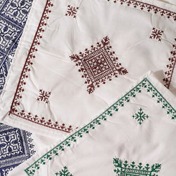 Embroidered Baby Linens - The care and discrimination that goes into selecting your own bedding shouldn't stop at the crib. The delicately crafted pieces are light and airy and a perfect choice for a nursery.