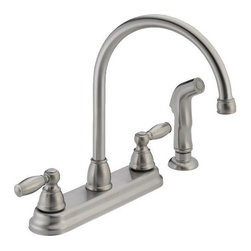 "DELTA FAUCET - P299575LFSS SS 2H KIT FAUCET - TWO-HANDLE HI-ARC KITCEHN FAUCET W/SPRAYER  High arc, rotating spout for accessibility  Ergonomic blade style handles  Matching side sprayer  4-hole 8"" installation-1/2""-14 male inlet shanks  Washerless stem cartridge valve  Flow rate: 1.8 gpm @ 60 psi  Spout length: 8-1/8"" - height: 11-1/2""  ADA and CA/VT compliant    P299575LFSS SS 2H KIT FAUCET    FINISH:Stainless Steel"