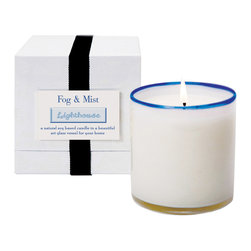 Fog and Mist / Lighthouse Candle - No harshness or artificiality can be detected in the sweet clouds of airy Fog and Mist scent exuded by the Lighthouse Candle. Mostly a light ozone breeze with the faintest touches of sea foam aroma and a greener note of kelp, the fragrance in this luxury oversized candle provides elemental freshness to a patio, bath, or living room; the sapphire-tinged art glass cup can be reused as a tea light holder.