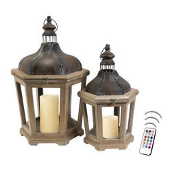 """Asian Import + USA - Paris Lantern Set with Flameless Color Candles - Paris Lanterns are hand crafted and feature wood and iron frames with a verdigris finish. The design is inspired by lanterns used years ago in the French countryside and the impressive glass and iron roof line completes the look in grand style. Their oversized stature is great for holding pillar candles. Sizes are 21~26.5"""" high and 11.5""""~15.5"""" wide respectively. Included are 5"""" and 6"""" Avion Select melted edge color wax candles with remote control timer. Note that candles pictured are for presentation only. The candles included in the set are described above. Set of 2"""