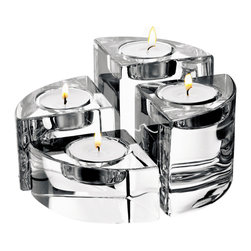 "Orrefors - Quartet Votives Set of 4 - Whether standing alone or clustered as a group of four in a cohesive collection, Quartet votives elicit ""oohs"" and ""ahhs"" and are among our most popular designs.  In addition to the pure beauty and cachet of gifts of Orrefors crystal, Quartet can be awarded for quarterly achievements, or an unique end-of-year gifts"