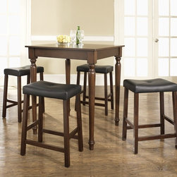 Crosley Furniture - 5 Pc Pub Dining Set w Turned Leg and Saddle S - Includes Pub Table and 4 Stools in Vintage Mahogany. Solid Hardwood & Veneer Construction Table . Solid Hardwood Stools. Hand Rubbed, Multi-Step Finish. Solid Hardwood, Fully Turned, Legs. Durable Stain Resistant Faux Leather PVC Seat. Table Dimensions: 36 in. H x 32 in. W x 32 in. D. Stool Dimensions: 40 in. H x 18.5 in. W x 22.5 in. DConstucted of solid hardwood and wood veneers, the 5 piece Pub / High Dining set is built to last. Whether you are looking for dining for four, or just a great addition to the basement or bar area, this set is sure to add a touch of style to any area of your home.