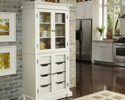 Home Styles - Home Styles Americana China Pantry - 5002-64 - Shop for Pantries from Hayneedle.com! The Home Styles Americana China Pantry offers a contemporary twist on traditional farmhouse style as well as plenty of storage space. Pastoral design elements are apparent in the strong lines of the recessed panel doors as well as in the prominent base and top moldings. The hardwood and engineered wood construction is finished in your choice of color. Brushed nickel hardware is the perfect accent. Ample storage can be found behind the four glass doors. The top doors contain two adjustable shelves and the bottom doors contain four large storage drawers. The shelves are equipped with plate grooves to display dishes. With its distinctive styling this pantry can be used in the kitchen dining room or any room where you need more storage. Assembly required