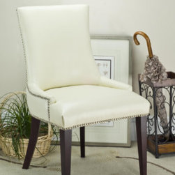Grandin Road - Becca Dining Chair - From Safavieh Home Furnishings. Solid wood frame and legs. Choose bi-cast leather or 100% linen upholstery. Fabric cover should be spot cleaned. Read more about bi-cast leather care. Trimmed with elegant nailhead accents, our Becca Dining Chair makes any meal a special occasion. This chair features low-rise arms and a clean, updated look that will add a sophisticated, yet comfortable, touch to your dining experience.  .  .  .  .  . Arrives fully assembled . Imported.