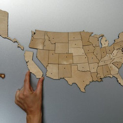 USA Magnetic Geography Puzzle - As a little one, rainy summer days were always spent indoors with a deck of cards or a puzzle. As an adult, I want to bring that back. What better way to do that than with Steven Mattern's birch plywood USA puzzle? It's patriotic and stimulating at the same time!