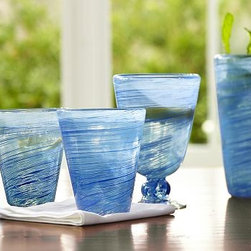 "Spun Recycled Glass Goblet, Set of 4, Blue - Subtle differences make each one of our earth-friendly glasses unique. DOF: 3.5"" diameter, 3.75"" high; 7 fluid ounces Goblet: 3.5"" diameter, 5"" high; 10.5 fluid ounces Tumbler: 3.5"" diameter, 6"" high; 17.5 fluid ounces Made of handblown recycled glass. Set of 6, of one type. Made in Mexico."