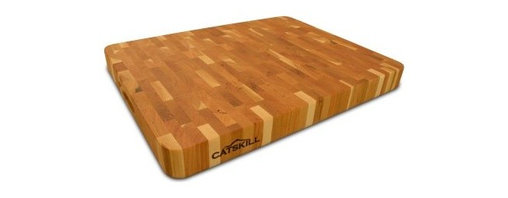 19 x 14.5 Professional End Grain Cutting Board - Heavy-duty cooking requires heavy-duty tools and that's what you'll get with the Professional End Grain Cutting Board – 19 x 14.5. Featuring a beautiful patchwork pattern this end-grain cutting board is super-durable and can handle all the whacking cutting pounding and slicing you can throw at it. It's reversible so you can always flip to a clean surface in the middle of your food prepping. Finger slots on each end make it easier to handle and carry. This makes a wonderful gift for any cooking enthusiast. This item is made from oil-finished natural yellow birch hardwood which is indigenous to the Northeastern U.S. and ranges in color from blond to a darker walnut shade; the natural variation in color allows this board to coordinate with your existing decor. Catskill Craftsmen's Eco-friendly PracticesCatskill Craftsmen is committed to protecting the environment through responsible forest management and manufacturing practices. Located in the Catskill Mountains of upper state New York Catskill Craftsmen plays a role in maintaining the health of the New York City watershed. This watershed provides clean water for New York City and other communities in the area. Healthy well-managed forests are better able to filter pollutants from entering streams and rivers which preserves the quality of watershed resources. With this goal in mind the company supports the efforts of the Watershed Agricultural Council (WAC). With the WAC Catskill Craftsmen encourages lumber suppliers (family forest owners and public land managers) to make wise harvesting decisions and control erosion in order to safeguard water quality. Other efforts to protect the environment include using sustainable wood sources and reducing wood waste. Catskill Craftsmen's manufactured items are made from naturally self-sustaining non-endangered North American hardwoods primarily birch and hard rock maple. All sawdust shavings and waste materials generated during the manufacturing process are converted into wood pellet fuel used to heat homes. This alternative heating source creates less ash and lower emissions than some other fuels. By operating their own wood pellet mill Catskill Craftsmen reduces their wood waste to zero. As natural resources become even more valuable Catskill Craftsmen will continue to advance proper stewardship of the pristine Catskill Mountain region. About Catskill CraftsmenFor over 60 years Catskill Craftsmen has provided customers with high-quality domestic hardwood ready-to-assemble products. Located in Stamford New York Catskill Craftsmen manufactures kitchen carts islands work centers gourmet butcher block chopping blocks cutting boards hardwood cabinets furniture book carts and racks. Catskill Craftsmen is recognized as the nation's leading manufacturer of premium wooden products.