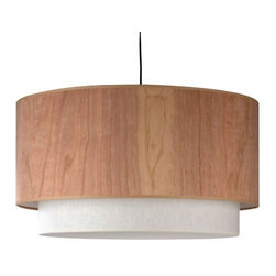 "Lights Up! - Woody Pendant by Lights Up! - Clean and customized with the warmth of wood. The Lights Up! Woody Pendant features a large outer drum in a variety of wood veneers. Peeking out from underneath, a smaller fabric drum (available in dozens of options) adds its own distinctive tone and pattern and diffuses the light of the two bulbs within. Lights Up! is dedicated to creating ""modern lighting for easy living."" Based in Brooklyn, New York, Lights Up! has been developing affordable contemporary pendants, floor and table lamps, and sconces since 1987. Lights Up! features lighting designs by Rachel Simon and offers printed fabric shades by innovative modern textile designer Thomas Paul and UK designer Camilla Meijer."