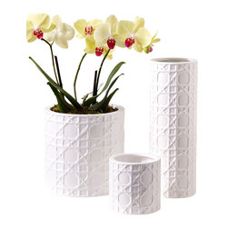 Ceramic Lattice Design Planters/Vases - Set of 3 - Elegant and continuous, the three-dimensional openwork wicker texture that wraps the Ceramic Lattice Design Planters or Vases allude gracefully to global styles in a pure white tone-on-tone styling. A set of three in the most useful sizes for the sunroom or for seasonal home decor, this arrangement of vases is perfect for setting off your chosen colors with a versatile highlight.