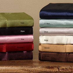None - Silky Satin King/ California King-size 4-piece Satin Sheet Set - Experience a great nights sleep with this stylish satin sheet set. Featuring a 100 percent polyester construction with a satin finish,this four-piece set offers comfort and durability. Available in several colors,it is sure to complement your decor.