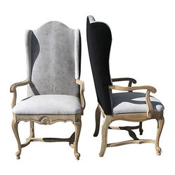 Cowhide Wingback Chairs-Pair - Not just for the ranch — this pair of dining chairs can hold their own in any setting. The luxurious cowhide front, crisp linen back and beautifully carved legs give these vintage wingbacks a subtle yet elegant western flair that you'll find quite appealing.