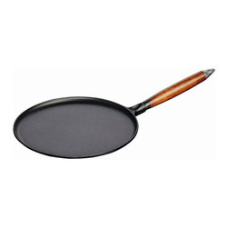"""Staub - 19.7"""" Crepe Pan - Features: -Crepe pan. -Pancake pan with wooden handle. -Material: Cast iron. -Includes one spreader and one spatula. -Constant and optimum performance. -Cast iron retains and evenly diffuses heat. -Easy to clean. -Induction hob compatible. -Made in France. -Staub provides lifetime guarantee. -Dimensions: 3.3"""" H x 19.7"""" W x 13.3"""" D."""