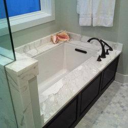 Calacatta Gold Marble Tub Undermount - Undermount tub with Calacatta gold marble