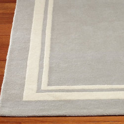 Harper Rug - Create a tailored space from the ground up with this plush rug. A frame of saturated color grounds the room in classic style.