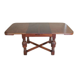 Antiques - Antique English Solid Oak 6Ft Dining Table w/ 2 Leaves - This is a handsome antique English solid oak 6ft dining table. Its top surface has very good wood grain quality and it has attractive curved corners. It includes two 12 inch leaves that extend the table from 47.75 to 71.75 inches. The leaves are darker and one of them has a discoloration but it is not distracting at all. It features gorgeous legs that have large carved balusters with rings and it has a traditional X stretcher with block feet. This piece may show minor age appropriate signs of wear including wood imperfections but as shown it is overall cosmetically and structurally in excellent condition for its age and it is strong and sturdy. Add a touch of elegance to your home decor with this beautiful piece of furniture!