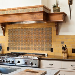 Fireclay Tile - Cuerda Seca - This backsplash features our Debris Series field tile in Maize Matte with an accent feature of Cuerda Seca's over the stove. Becuase Cuerda Seca's are handmade, they are fully customizable. Were happy to suggest some of our favorite color pallets.