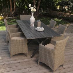 Belham Living Bella All Weather Wicker Patio Dining Set - Seats 6 - Delivering a true combo of natural aesthetics and all-weather performance the Bella All Weather Wicker Patio Dining Set - Seats 6 features eco-friendly easy-to-maintain materials. This seven piece set includes a rectangular faux wood dining table and six resin wicker dining arm chairs. A rust-proof all-aluminum frame on the chairs supports a weather-proof resin wicker exterior. This resin material has a remarkably natural feel and the variegated tones only help to increase its authenticity. You can leave resin wicker out year-round and it won't fade crack or peel. Seat cushions of spun-poly are included for added comfort. The table is inspired by traditional picnic tables with intersecting legs and a slatted top. It's faux wood with a pressed finish so you get the look of real wood without the weathering or upkeep. A durable aluminum base keeps this top well-supported. This whole seat is easy to clean with soap and water. Redesigned table features umbrella hole. Additional Information Chair Dimensions: 25.5W x 22.5D x 33.75H inches Table Dimensions: 82.75L x 39.5W x 29.5H inches Seat Dimensions: 18W x 20D inches Seat Height: 19H inches Back Height from Seat: 21H inches Arm Height: 25H inches Assembly Disclaimer: Insure stability of the assembled table by checking that all legs are fastened tightly against the bottom of the table top. About Belham Living Belham Living builds catalog-quality furniture in traditional styles at a price that actually makes sense. By listening to our customers and working closely with great manufacturers we build beautiful pieces worthy of your home. Rich wood finishes attention to detail and stylish lines that tie everything together are some of the hallmarks of a Belham Living piece. From the living room or bedroom through the kitchen and out onto the deck there's something from an incredible Belham collection perfect for your style.