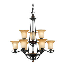 Quoizel Lighting - Quoizel GE5009SE Genova 9 Light Chandelier, Stonehedge - This pretty design is inspired by the Italian port city of Genova, rich in diverse architecture and of an enduring, unassuming spirit. The gently twisted glass is reminiscent of the winding city streets, and the dual finish, Stonehedge, is an exciting combination of Burnished Copper and Ombra.