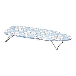 """Home Decorators Collection - Handy Board® - Our aptly-named Handy Board® is the versatile ironing board you're looking for. This board features a strong steel mesh ironing surface, a 100% cotton cover and a fiber pad. The steel legs fold under for storage. Most conveniently, this board has a swivel hook that allows you to hang it on commercial or residential doors or on a closet rod. Ample 12"""" x 30"""" ironing surface. Fold-away legs. Swivel hook for hanging."""