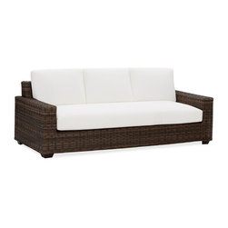 Torrey All-Weather Wicker Square Sofa & Cushion Set - This sofa has all the elegant beauty of rattan but is made of synthetic fiber, making it even more durable. It makes for a versatile piece that even has the option of cushion slipcovers to change up your look. I could see it with preppy striped pillows or a bohemian mixture.